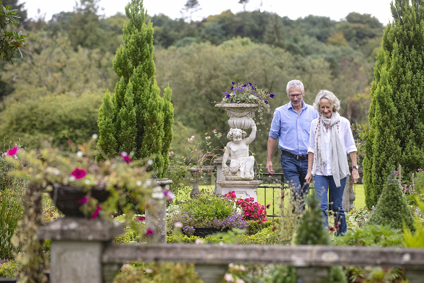 A couple walking in the gardens of Blessingbourne Estate