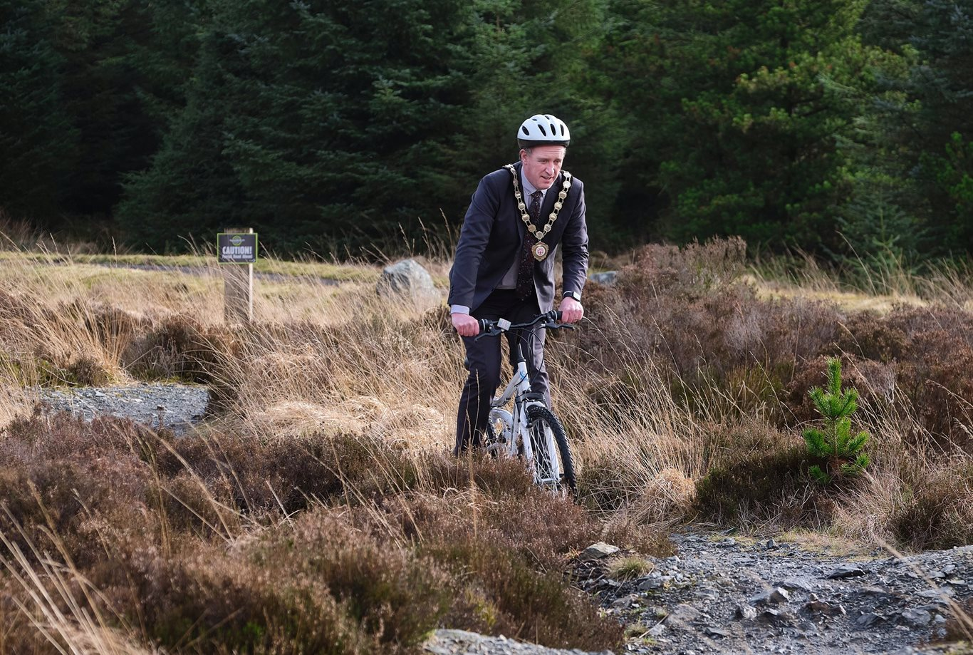 The Chair of the Council, Councillor Cathal Mallaghan, on a mountain bike at Davagh Forest